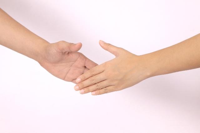 示談で握手のイメージ